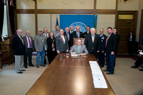 Gov. Jay Inslee signs Senate Bill No. 5775, April 2, 2014. Relating to allowing for a veteran designation on drivers' licenses and identicards.