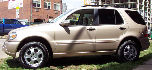 gold mercedes SUV