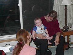 Zayden laughing with Alyssa and Grandma