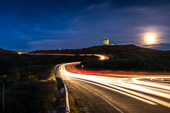 full moon night and light trails on Signal Hill, St. John's photo by tuanland