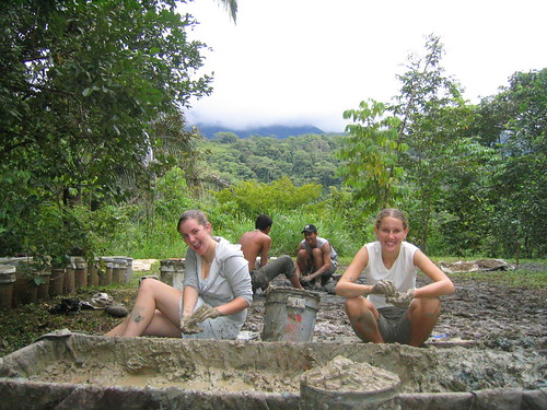 Clay sifting for Cob, Cob dancers in the background