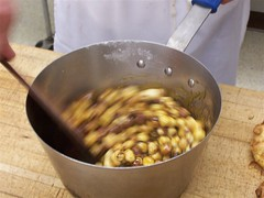 sugar reduction & nuts are briskly stirred to coat nuts