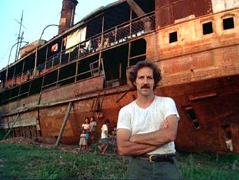 Herzog in front of boat and Indians
