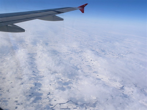 flying over snowy ground (actually, it's Michigan).