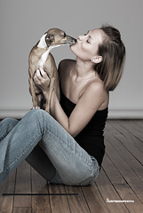 Portrait of Cori Lee, a young caucasian woman with red hair and hazel eyes, holding Darwin, the Italian Greyhound photo by HuntsmanPhoto