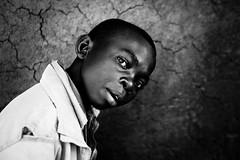 Lendu boy puzzled by my camera  - DR CONGO - photo by C.Stramba-Badiali