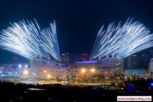 Fireworks explode over the Beijing National Stadium - Bird's Nest for the opening ceremony of the Beijing 2008 Olympic Games