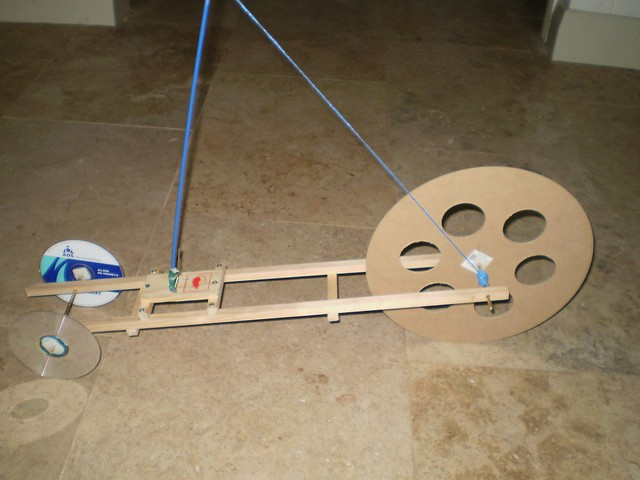 mousetrap car final paper I saw that the car that they made on this website had eye screws attached to the mouse trap to hold the axle, which i thought was a good idea i also saw that the car on this site used pens for axles, and had cds as wheels.
