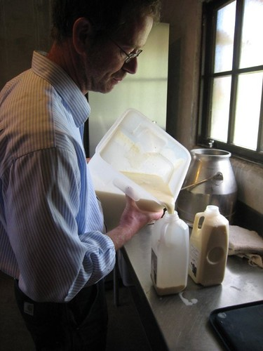 Kurt Timmermeister pours milk