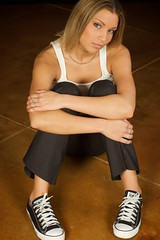 Portrait of Rachelle, a young blond caucasian woman wearing a white tank top, black slacks and converse shoes photo by HuntsmanPhoto