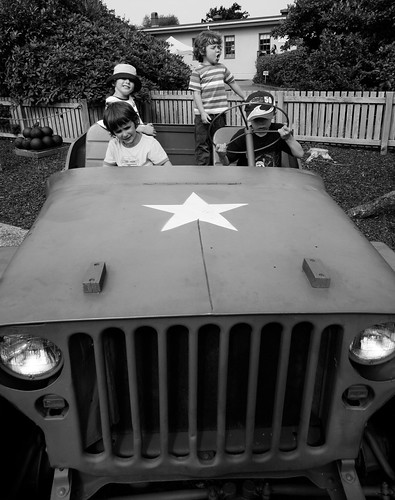 Four boys in a Jeep