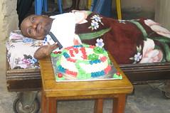 Joshua Gidado cutting cake