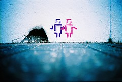 a hole and 2 little stencil men photo by lomokev