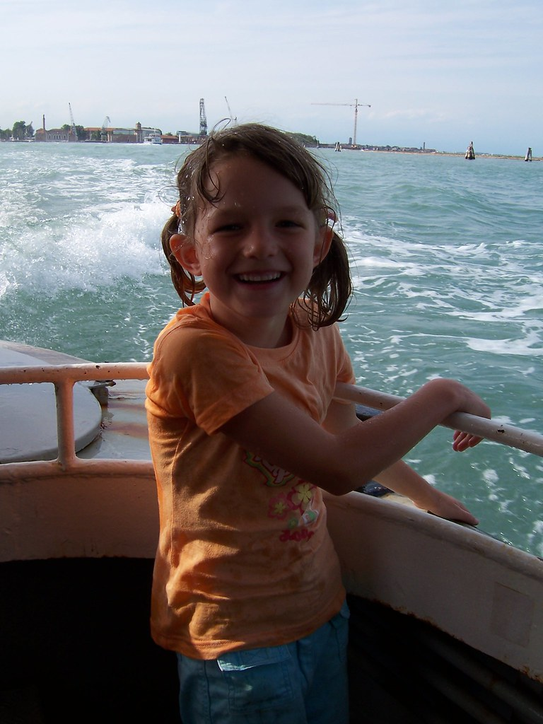 Ariana gets up close and personal with some Venetian boat wash.
