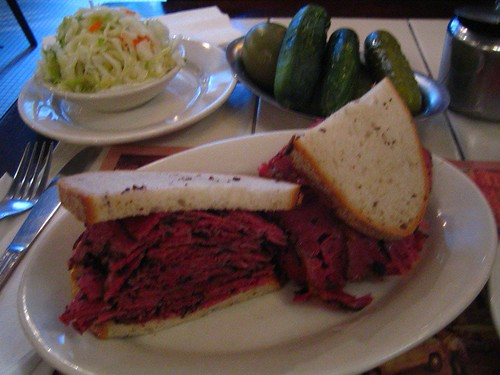 Pastrami sandwich, pickles and coleslaw
