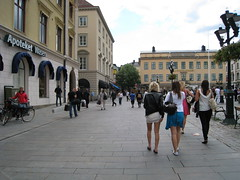People walking on the street by the Linköping market place