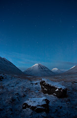 A Nightscape. With two rocks and a mountain. photo by Hugi Hlynsson