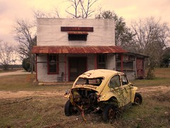 Abandoned Store with Yellow VW Bug photo by Brian Brown Photography/Vanishing Media