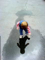 discovering his reflection in a puddle - DSC00833