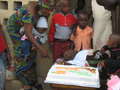 Joshua and friends cutting cake