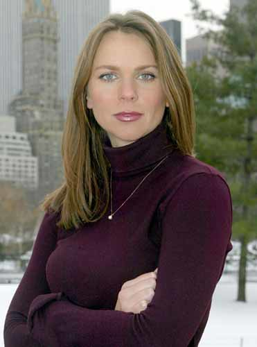 Lara Logan in Swimsuit. Lara Logan with arms folded