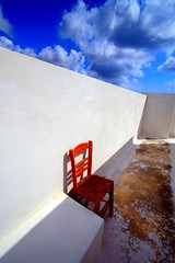Red chair and white wall photo by Marite2007