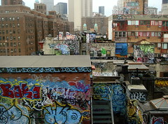 Graffiti atop buildings in China Town in New York photo by margaret mendel