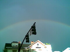 A rainbow behind the traffic lights