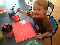 Finn painting pink at the art workshop