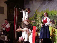 Austrian theater guys spank each other inverted. In lederhosen, mind you... (video)