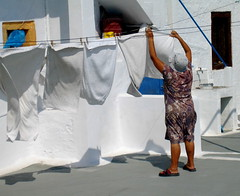 old woman drying towels