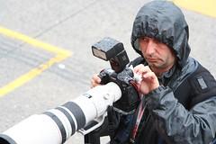 Working cameraman in heavy rain