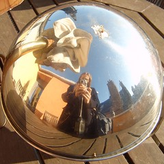 Myself in a metal globe ashtray