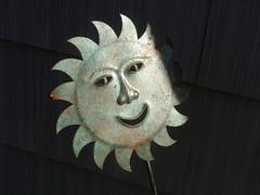 metal sun in a gloomy garden