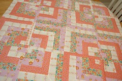 Baby Quilt inspired by Matreshka fabric from Heather Ross photo by The Driftwood Thimble
