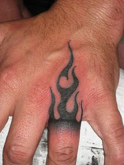 Tribal Flame hand tattoo by Jon Poulson photo by Aloha Salt Lake Tattoos