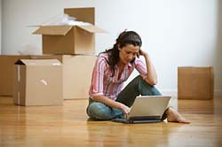Woman on Internet instead of packing boxes