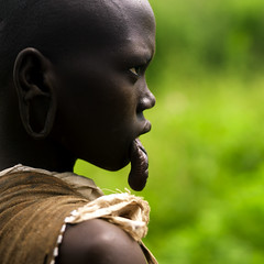Mursi girl without lip plate, Ethiopia photo by Eric Lafforgue