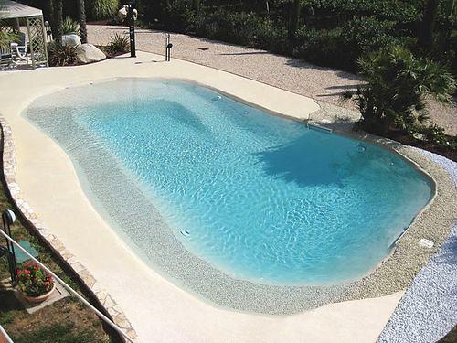 Construye una playa en tu casa con las piscinas de arena for Piscinas de arena compactada