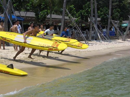 Surf Board Race: Paddling on a lifesaving surfboard around a circuit