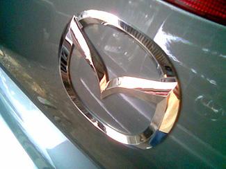 Silvery Mazda logo
