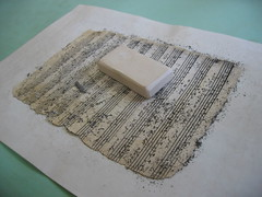 Sheet of music being cleaned