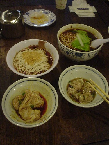Clockwise from upper right: hot and sour noodles, white oil wontons, red oil wontons, and dan dan mian