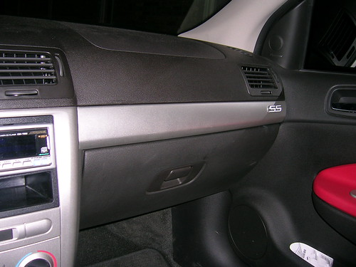 2006 Chevy Cobalt Stereo - To Get To The Radio First Remove The Silver Trim Panel Above The Glove Box - 2006 Chevy Cobalt Stereo