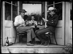 Three men playing cards in an alcove photo by Powerhouse Museum Collection