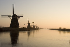 Dutch Windmiles at Sunset photo by Bas Lammers
