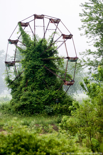 Abandoned Ferris Wheel photo by City Eyes