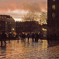 Parvis de Notre Dame at Sunset ~ Rita Crane Photography:  France / Paris / people / rain / reflection / umbrellas / street / building / photography / silhouette / notre dame / sunset  colors photo by Rita Crane Photography