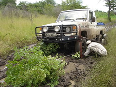 Land Cruiser on a jack in the mud
