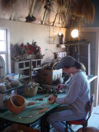 Sue in her shop